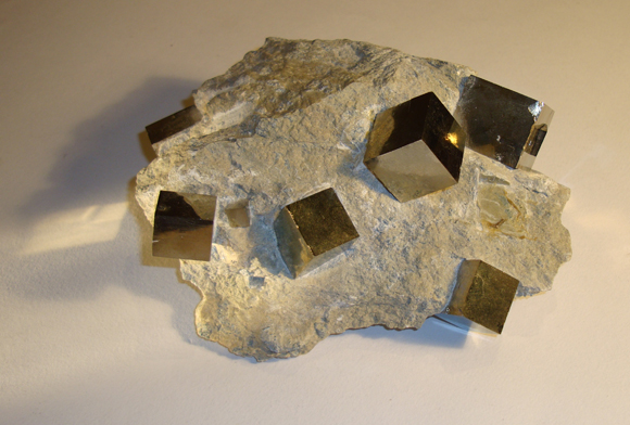 Natural Iron Pyrite in Limestone Matrix